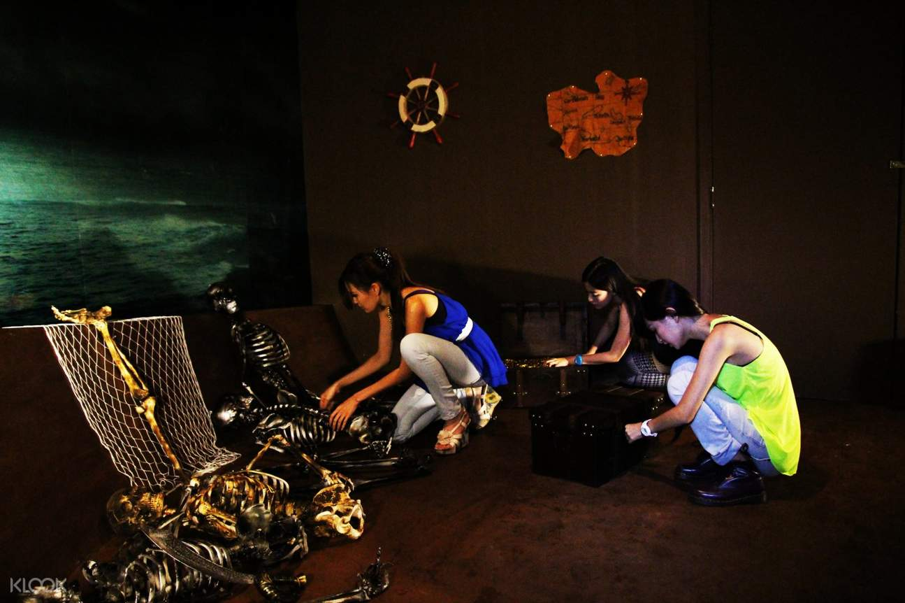 People rummaging through chest in Escape Room Kuala Lumpur
